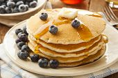 foto of buttermilk  - Homemade Buttermilk Pancakes with Blueberries and Syrup for Breakfast