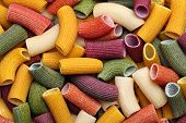 stock photo of pene  - Background image of colorful italian pasta texture - JPG