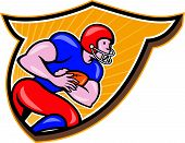 picture of scat  - Illustration of an american football gridiron running back player running rushing with ball facing side set inside shield crest done in cartoon style - JPG