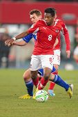 VIENNA,  AUSTRIA - MARCH 22 David Alaba (#8 Austria) and Frodi Benjaminsen (#7 Faroe Islands) fight