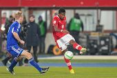 VIENNA,  AUSTRIA - MARCH 22 David Alaba (#8 Austria) kicks the ball during the world cup qualifier g