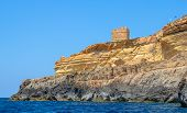 picture of grotto  - Coastal watch tower from the sea in the Blue Grotto in Malta - JPG
