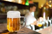 pic of spigot  - a glass of beer in the pub - JPG