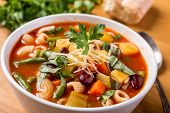 stock photo of onion  - Bowl of Minestrone Soup with Pasta - JPG
