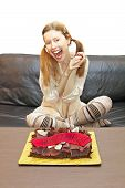 foto of sweet sixteen  - Young teenage girl celebrating sixteen birthday with chocolate cake - JPG