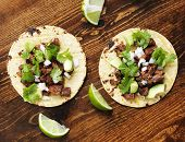 image of tacos  - overhead view of two authentic street tacos - JPG