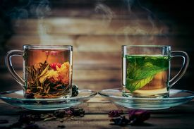 pic of peppermint  - Glass cups with tea flower and peppermint tea against wooden background  - JPG