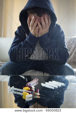 Sad Man Doing Snorting Cocaine At Home On His Own
