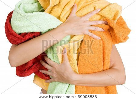 Woman Holding A Lot Of Colorful Laundry In Her Hands, Isolated On White