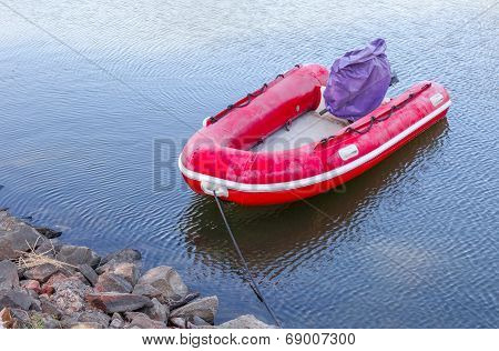 Red Rubber Boat At The Waterside