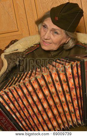 Elderly woman solder playing accordion