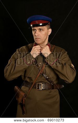 Colonel commander with a gun