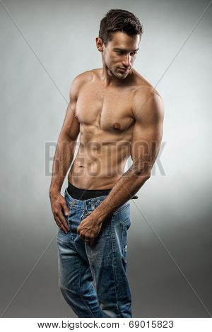 Handsome muscular man posing with no shirt