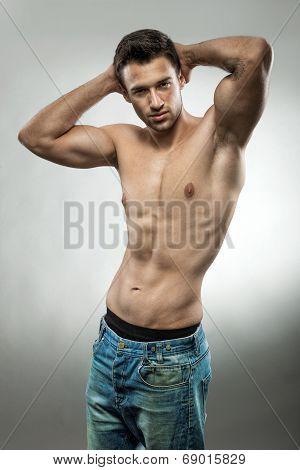 Handsome muscular man posingwith no shirt