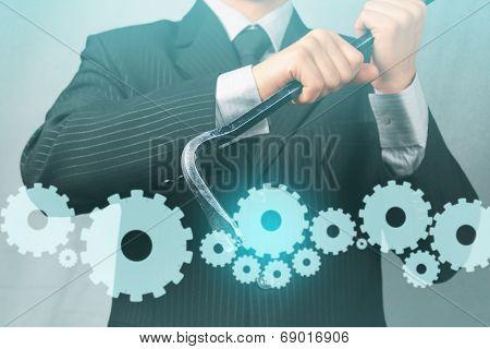 Businessman Holds Crowbar With Cogwheels