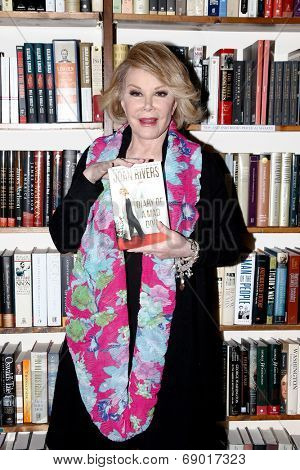 HUNTINGTON, NY-JUL 25: TV host Joan Rivers signs copies of her book,