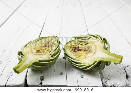 Artichoke Cut In Half On Wooden White Table
