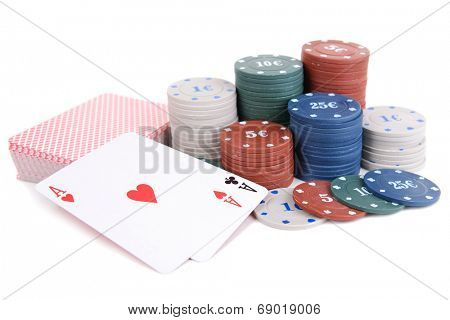 Cards and chips for poker isolated on white