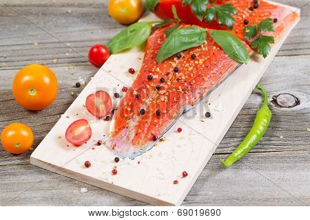 Fresh Salmon And Ingredients On Wooden Cooking Plank