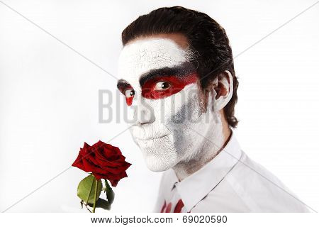 Man With White Mascara And Red Rose