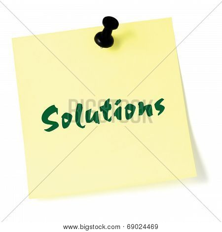 Solutions, Written On A Sticky Adhesive Note, Isolated Yellow Post-it Style Sticker, Black Thumbtack