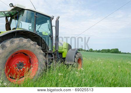 Field Work Tractor In Meadow