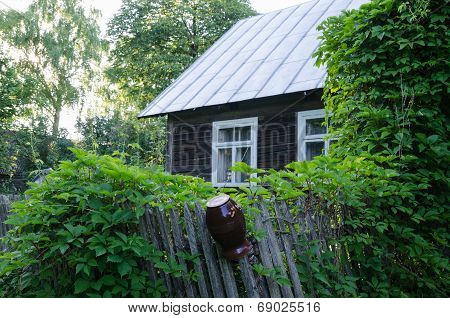 Old Country House With Windows And Fence Clay Jug