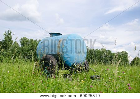 Blue Water Cistern Drink For Animal Between Grass
