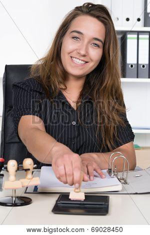 Woman Is Pressing A Stamp At Stamp Pad