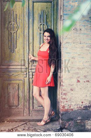 Retro Image Of Cute Girl Near The Old Door