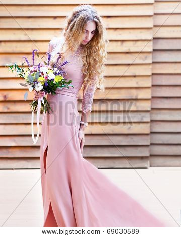 Bride Holding The Wedding Bouquet With Succulent Flowers