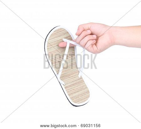 Male hand holding flip-flop.