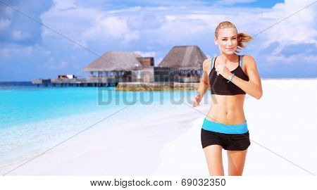 Beautiful sportive female running on the beach, workout on luxury Maldives resort, doing fitness exercises outdoors, healthy lifestyle, active summer vacation concept