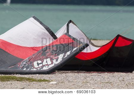 A Surging Kite Lying On A Beach In The Lake Of Santa Croce