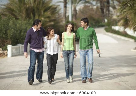 Four Happy People Walking