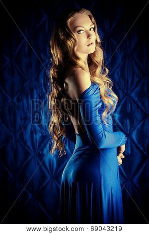 Portrait of a magnificent young woman with beautiful wavy hair. Fashion shot.