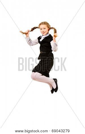 Cheerful ten years girl jumping for joy. Isolated over white.