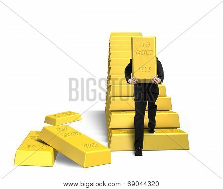 Businessman Carrying Bullion On Golden Stairs