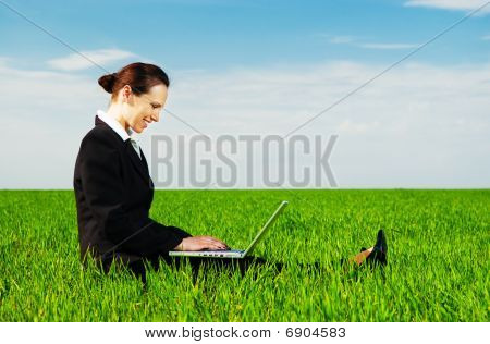 Smiley Woman Resting With Laptop