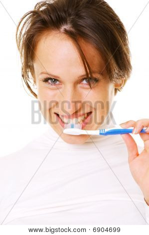 Smiley Young Woman Cleaning Her Teeth