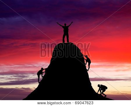 Man On Top Of The Mountain And The Other People To Climb Up.