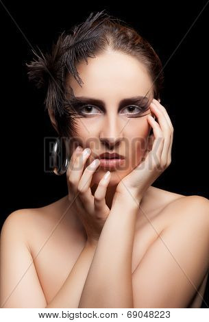 Woman With Feather And Goth Make Up On Black Background