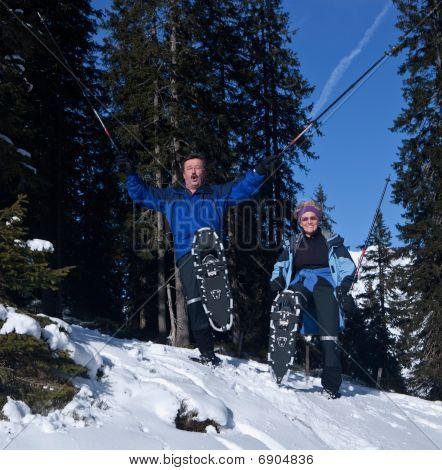 Happy Seniors In The Snow