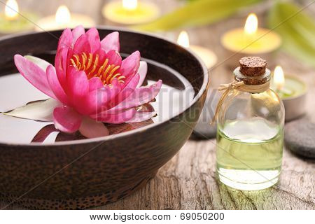 Spa still life with perfume bottle and lotus flower