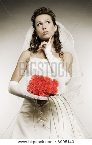 Thoughtful Bride With Bunch Of Flowers