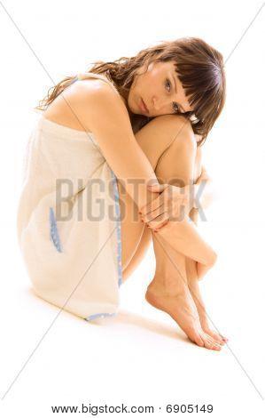 Thoughtful Woman In White Bathrobe