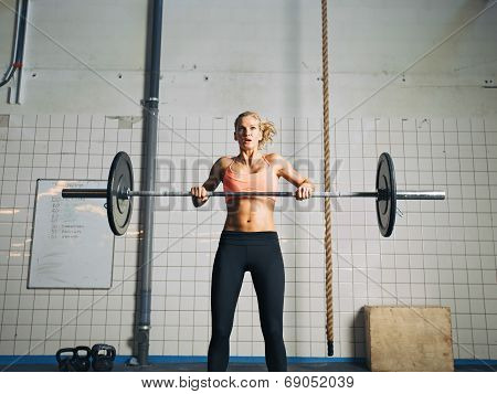 Young Woman Lifting Heavy Weights