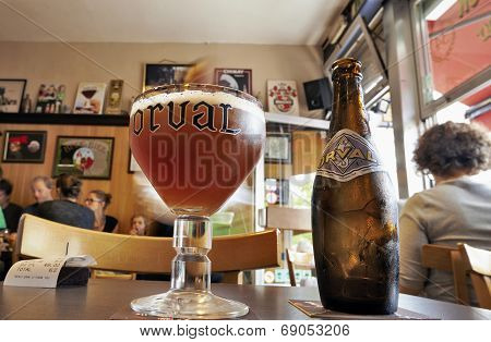 Orval Trappist Belgian Ale Bottle And Glass On A Table