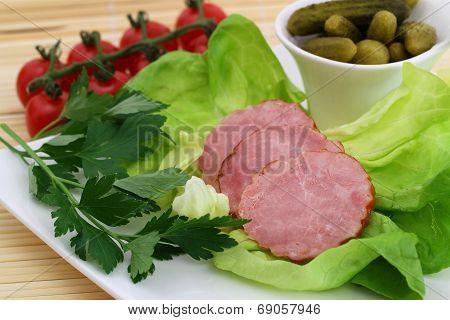 Traditional Polish smoked sausage on lettuce leaves