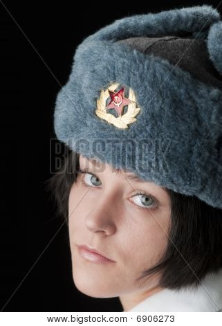 Beautiful blue eyed woman in Russian Ushanka hat